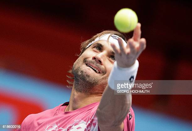 Spain's David Ferrer serves to Portugal's Joao Sousa during the ATP Tennis tournament in Vienna Austria on October 27 2016 / AFP / APA / GEORG...