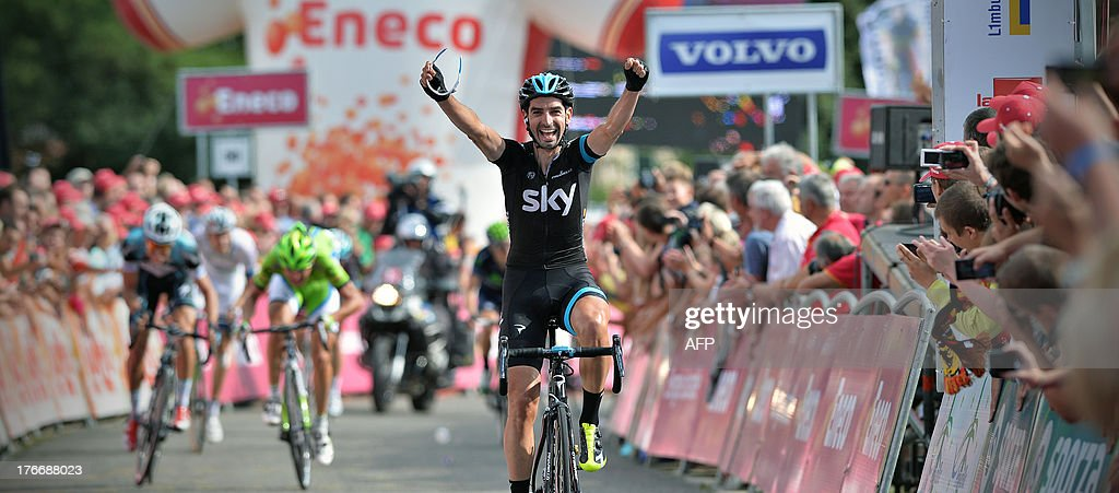 Spain's David Garcia Lopez of Team Sky celebrates as he crosses the finish line to win the sixth stage of the Eneco Tour cycling race, from Riemst to La Redoute, in Aywaille, on August 17, 2013. The event, formerly known as the Tour of Benelux, takes the peloton through Belgium and the Netherlands over seven stages and 1,080km.