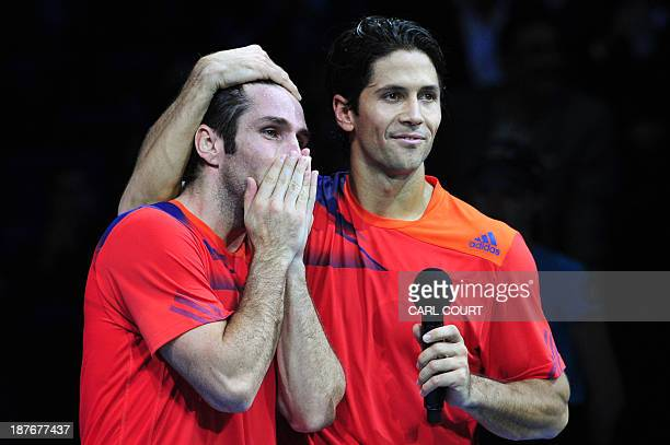 Spain's David Marrero and his partner Spain's Fernando Verdasco are interviewed on court during the presentation after beating US player Bob Bryan...