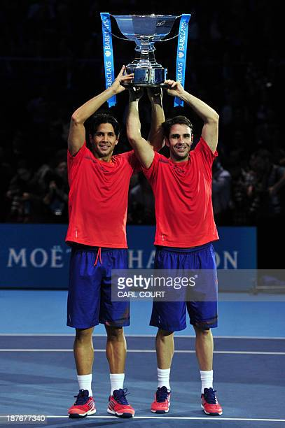 Spain's David Marrero and his partner Spain's Fernando Verdasco pose with the winners' trophy during the presentation after beating US player Bob...