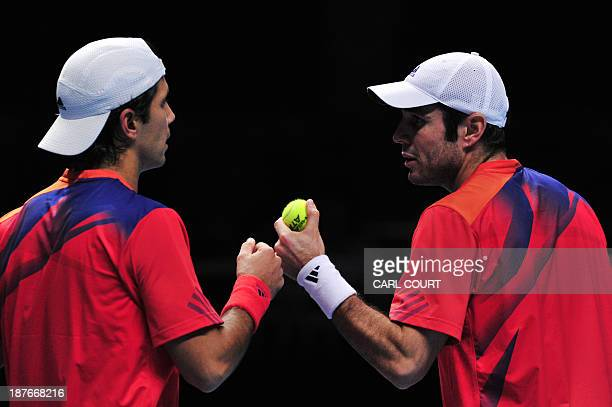 Spain's David Marrero and his partner Spain's Fernando Verdasco touch fists between points against US player Bob Bryan and his partner US player Mike...