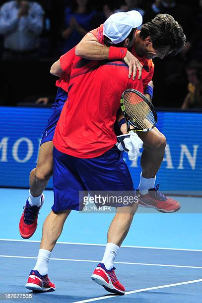 Spain's David Marrero and Spain's Fernando Verdasco celebrate beating US player Bob Bryan and US player Mike Bryan in the doubles final on the eighth...