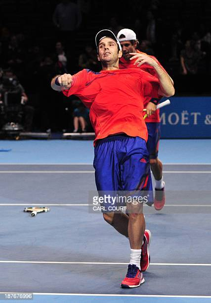 Spain's David Marrero throws his armband into the crowd as he celebrates with partner Spain's Fernando Verdasco after beating US player Bob Bryan and...