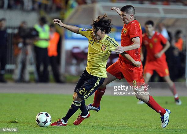 Spain's David Silva and Macedonia's Velice Sumulikovskii run for the ball during an international friendly World Cup 2010 football match between...
