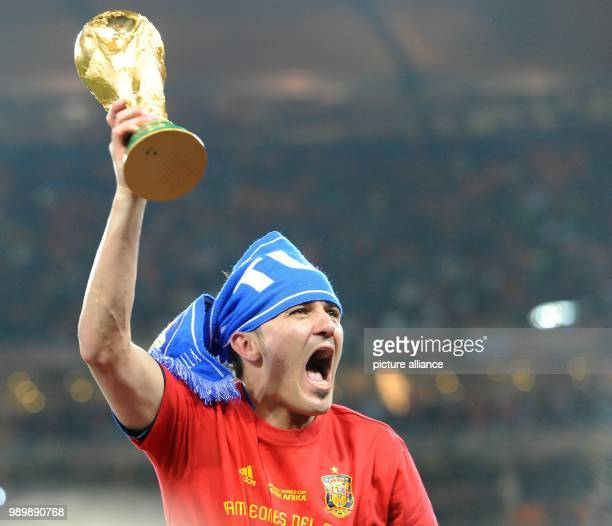 Spain's David Villa lifts the World Cup trophy after the 2010 FIFA World Cup final match between the Netherlands and Spain at Soccer City Stadium in...