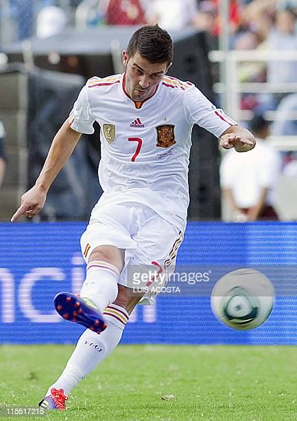 Spain's David Villa shoots to score against Venezuela during their friendly football match at the Jose Antonio Anzuategui stadium in Puerto la Cruz...