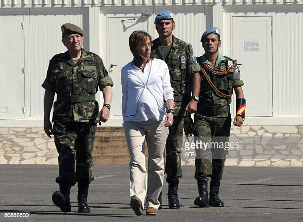 Spain's Defence Minister Carme Chacon inspects the honour guard during her visit to the UNIFIL Spanish forces based close to Marjayoun in southern...