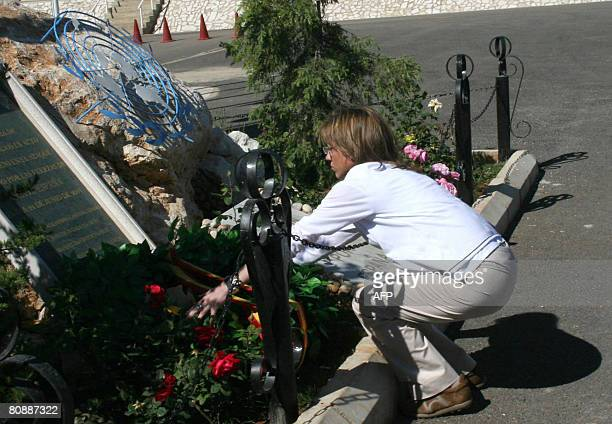 Spain's Defence Minister Carme Chacon lays a wreath during her visit to the UNIFIL Spanish forces based close to Marjayoun in southern Lebanon on...