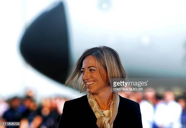 Spain's Defence Minister Carme Chacon smiles after signing the final contract for the financing of the Airbus A400M military transport plane with the...