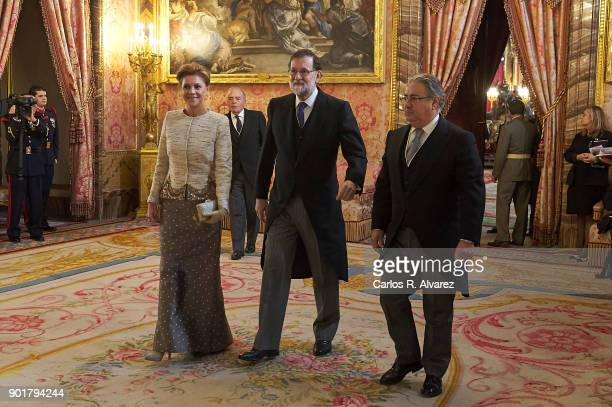Spain's Defence Minister Maria Dolores de Cospedal Spanish Prime Minister Mariano Rajoy and Spain's Interior Minister Juan Ignacio Zoido attend the...