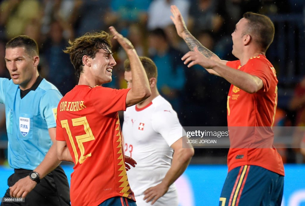 Spain's defender Alvaro Odriozola (L) celebrates a goal with Spain's midfielder Thiago during the international friendly football match between Spain and Switzerland at La Ceramica stadium in Vila-real on June 3, 2018.