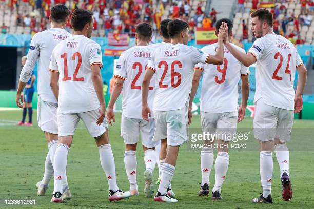 Spain's defender Aymeric Laporte celebrates scoring his team's second goal with teammates during the UEFA EURO 2020 Group E football match between...