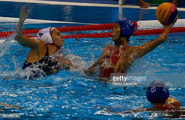 Spain's defender Beatriz Ortiz Munoz and China's Zhao Zihan vie for the ball during the Rio 2016 Olympic Games Waterpolo match Spain vs China at the...