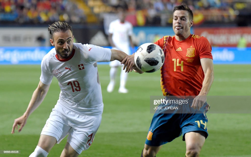 Spain's defender Cesar Azpilicueta (R) vies with Switzerland's forward Josip Drmic during the international friendly football match between Spain and Switzerland at La Ceramica stadium in Vila-real on June 3, 2018.