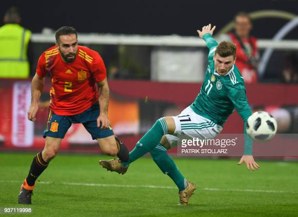 Spain's defender Dani Carvajal and Germany's forward Timo Werner vie for the ball during the international friendly football match of Germany vs...