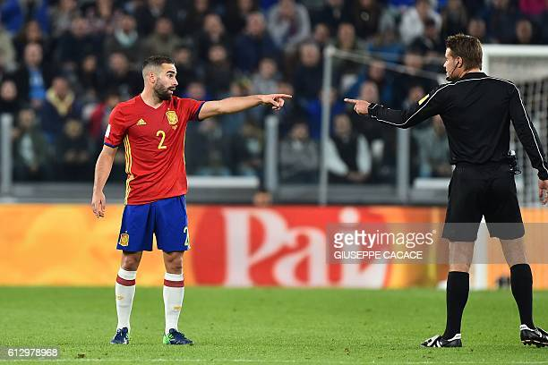 Spain's defender Dani Carvajal argues with referee Felix Brych during the WC 2018 football qualification match between Italy and Spain on October 6...