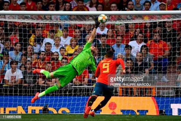 TOPSHOT Spain's defender Dani Carvajal challenges Sweden's goalkeeper Robin Olsen during the UEFA Euro 2020 group F qualifying football match between...
