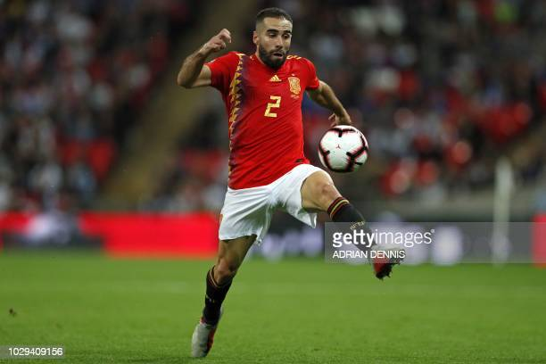 Spain's defender Dani Carvajal controls the ball during the UEFA Nations League football match between England and Spain at Wembley Stadium in London...