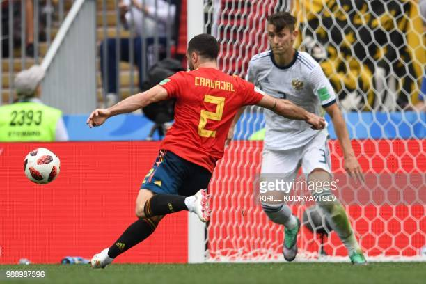 Spain's defender Dani Carvajal kicks the ball past Russia's defender Ilja Kutepov3 during the Russia 2018 World Cup round of 16 football match...