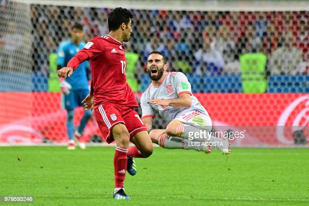 TOPSHOT Spain's defender Dani Carvajal reacts during the Russia 2018 World Cup Group B football match between Iran and Spain at the Kazan Arena in...
