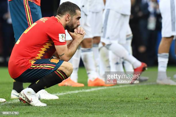 Spain's defender Dani Carvajal reacts to Russia's victory after the penalty shootout at the end of the Russia 2018 World Cup round of 16 football...