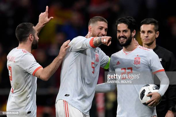 Spain's defender Dani Carvajal Spain's defender Sergio Ramos and Spain's midfielder Isco celebrate after a friendly football match between Spain and...