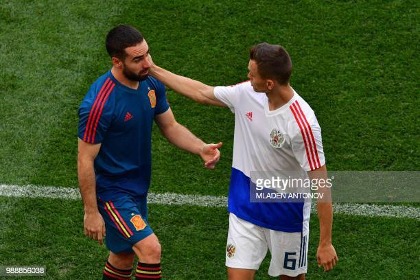 Spain's defender Dani Carvajal speaks with Russia's midfielder Denis Cheryshev prior to the Russia 2018 World Cup round of 16 football match between...