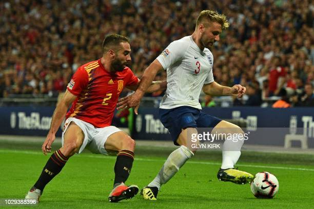 Spain's defender Dani Carvajal vies with England's defender Luke Shaw during the UEFA Nations League football match between England and Spain at...