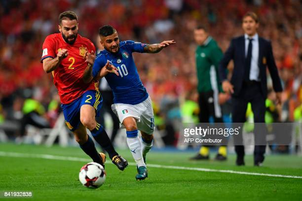 Spain's defender Dani Carvajal vies with Italy's forward Lorenzo Insigne during the World Cup 2018 qualifier football match Spain vs Italy at the...