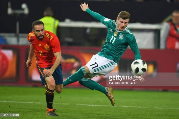 Spain's defender Daniel Carvajal and Germany's striker Timo Werner vie for the ball during the international friendly football match of Germany vs...