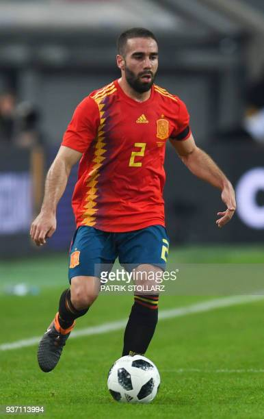 Spain's defender Daniel Carvajal runs with the ball during the international friendly football match of Germany vs Spain in Duesseldorf western...