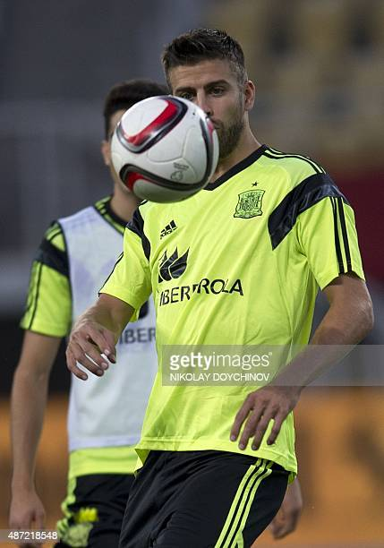 Spain's Defender Gerard Piqué controls the ball during a training session at the Filip II Arena stadium in Skopje on September 7 on the eve of their...