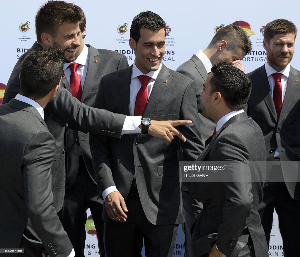 Spain's defender Gerard Pique and midfielders Sergi Busquets and Xavi Hernandez gather for a group picture of the Spanish football team with Spain's Prince Felipe on May 24, 2010, at the Sports City of Las Rozas, near Madrid. Spain, among the favourites for the World Cup, which runs from June 11-July 11, face Switzerland, Honduras and Chile in Group H of the opening round.