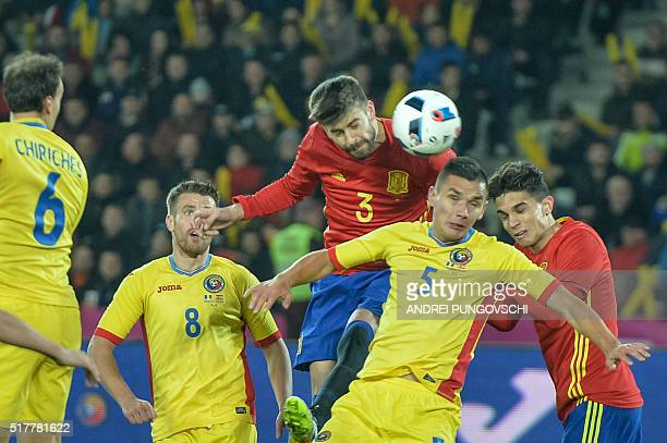 Spains defender Gerard Pique and Romanias defender Ovidiu Stefan Hoban vie for the ball during the friendly football match between Romania and Spain...