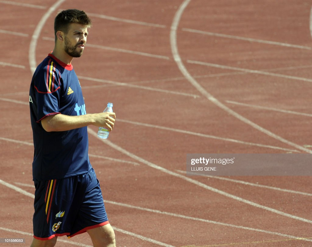 Spain's defender Gerard Pique arrives for a training session of the Spanish football team on May 26, 2010, at the Sports City of Las Rozas, near Madrid. Spain, among the favourites for the World Cup, which runs from June 11-July 11, face Switzerland, Honduras and Chile in Group H of the opening round.
