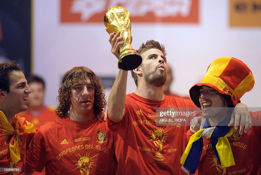 Spain's defender Gerard Pique holds up t : News Photo