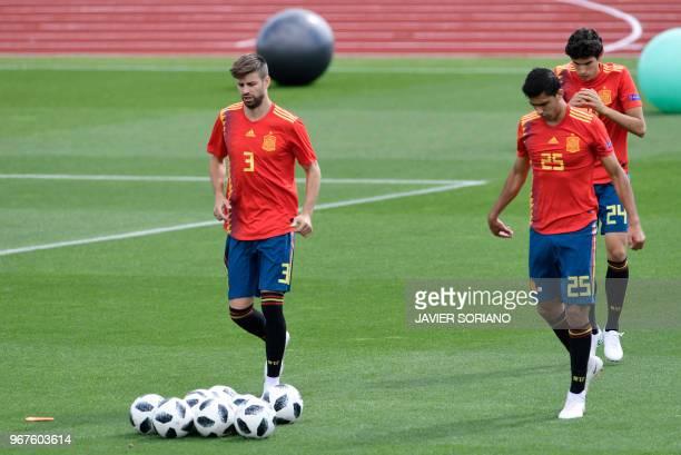Spain's defender Gerard Pique Spain's midfielder Rodri and Spain's defender Jesus Vallejo attend a training session at Las Rozas de Madrid sports...