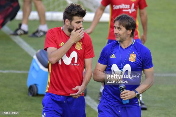 Spain's defender Gerard Pique speaks with Spain's coach Julen Lopetegui during the training session at the New Condomina stadium in Murcia on June 6...