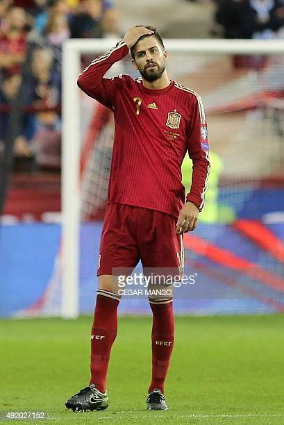 Spain's defender Gerard Pique stands during the Euro 2016 qualifying football match Spain vs Luxembourg at Las Gaunas stadium in Logrono on October 9...