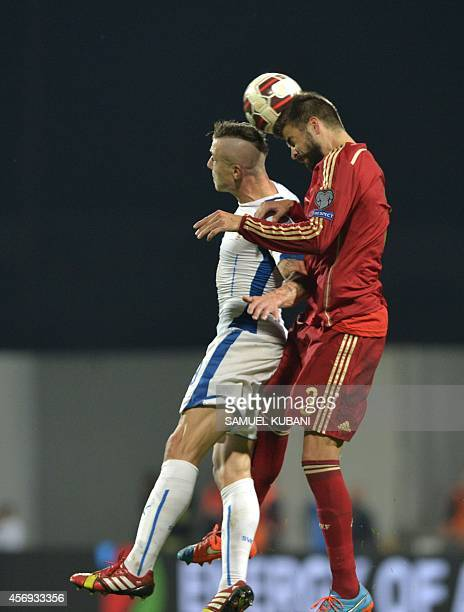 Spain's defender Gerard Pique vies for a ball with Slovakia's midfielder Juraj Kucka during Euro 2016 qualifing football match between Slovakia and...
