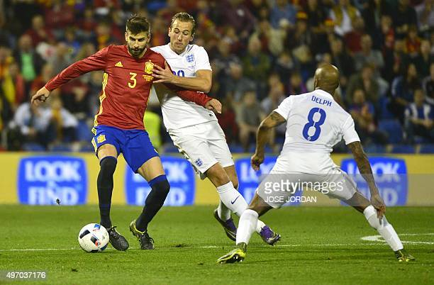 Spain's defender Gerard Pique vies with England's forward Harry Kane during the friendly football match Spain vs England at the Jose Rico Perez...