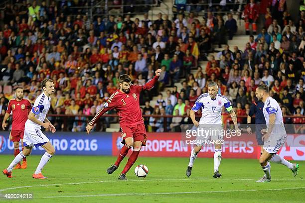 Spain's defender Gerard Pique vies with Luxembourg's midfielder Mario Mustch during the Euro 2016 qualifying football match Spain vs Luxembourg at...