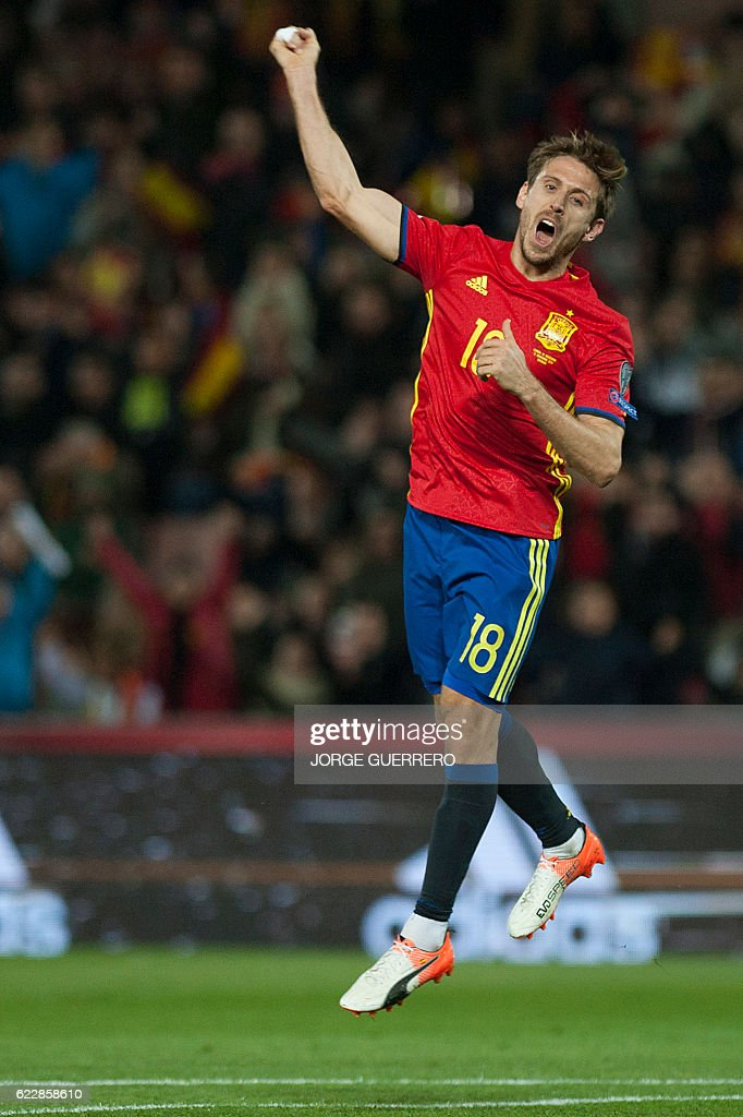 Spain's defender Ignacio Monreal celebrates after scoring during the FIFA qualifying Group G football match Spain vs Macedonia at Los Carmenes stadium in Granada, on November 12, 2016. / AFP / JORGE