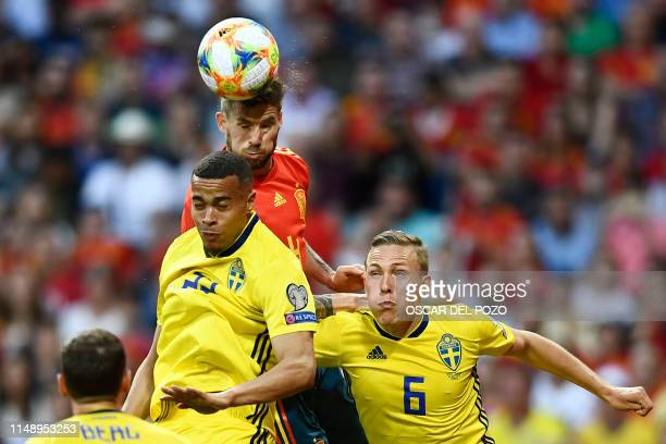 Spain's defender Inigo Martinez vies with Sweden's forward Robin Quaison and Sweden's defender Ludwig Augustinsson during the UEFA Euro 2020 group F...