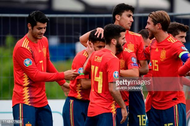Spain's defender Jesus Navas celebrates with teammates after scoring during the UEFA Euro 2020 group F qualifying football match between Faroe...