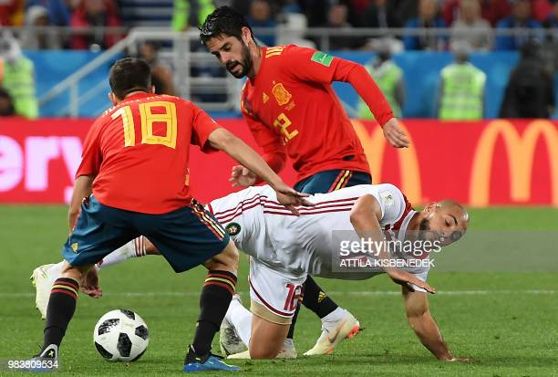 Spain's defender Jordi Alba and Spain's midfielder Isco vie with Morocco's forward Noureddine Amrabat during the Russia 2018 World Cup Group B...
