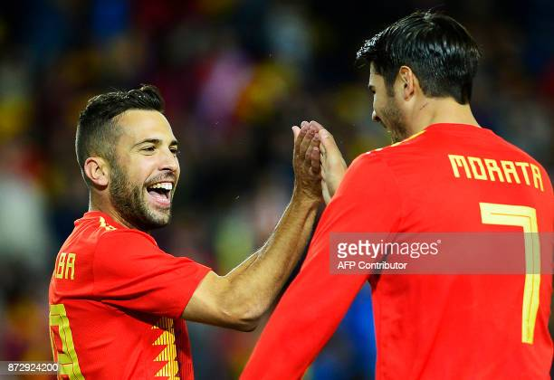 Spain's defender Jordi Alba celebrates with Spain's forward Alvaro Morata after scoring a goal during the international friendly football match Spain...