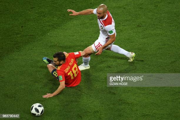 Spain's defender Jordi Alba falls past Morocco's forward Noureddine Amrabat during the Russia 2018 World Cup Group B football match between Spain and...