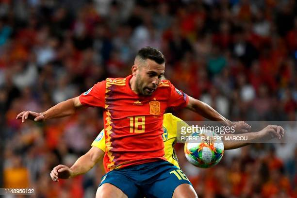 Spain's defender Jordi Alba jumps for the ball in front of Sweden's midfielder Sebastian Larsson during the UEFA Euro 2020 group F qualifying...