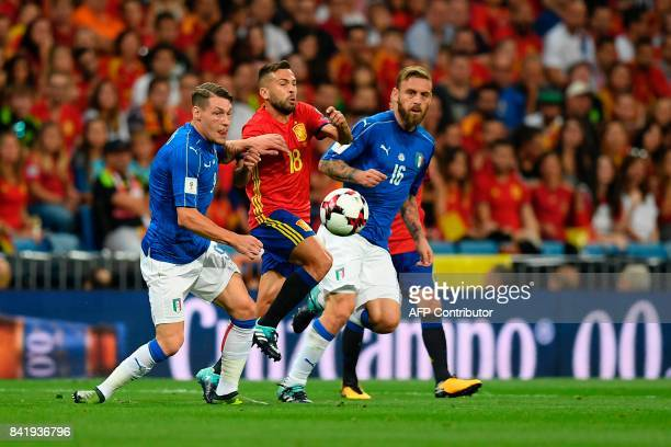 Spain's defender Jordi Alba vies with Italy's forward Andrea Belotti and Italy's midfielder Daniele De Rossi during the World Cup 2018 qualifier...